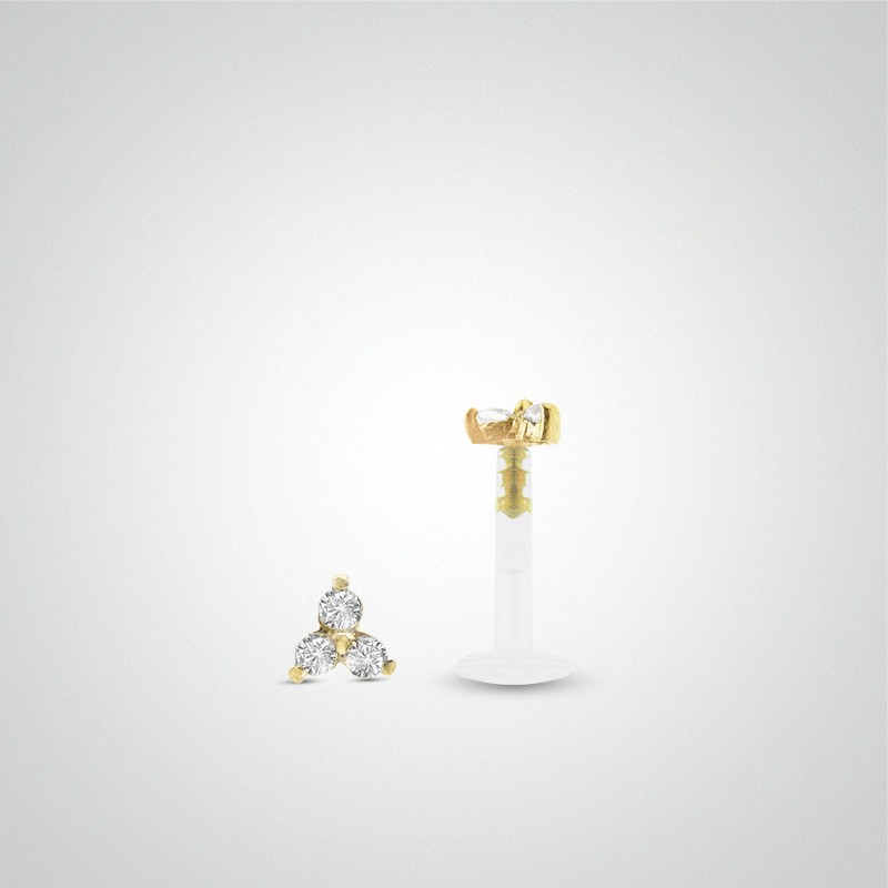 18 carats yellow gold 3 zirconium oxides cartilage piercing (helix).