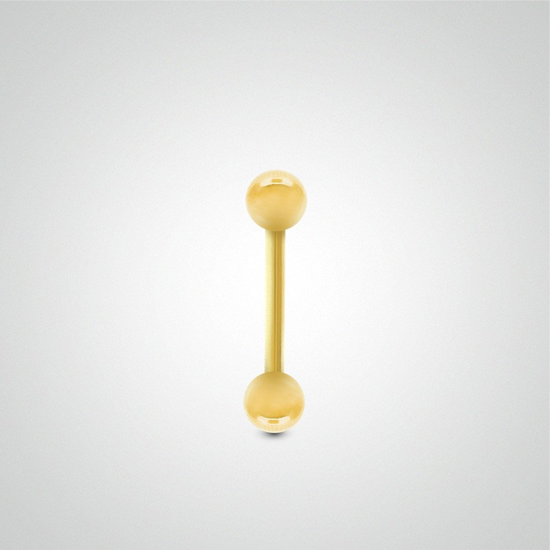 18 carats yellow gold genital piercing 1,2mm(16ga) with balls.