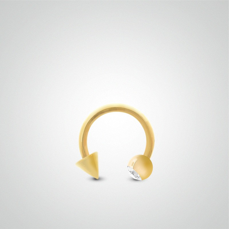 18 carats yellow gold cartilage (helix) piercing 1,2mm(16ga) with zirconium oxide ball and spike.