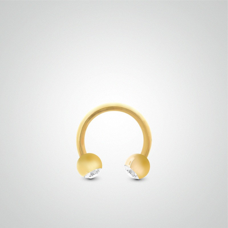 18 carats yellow gold circular ring cartilage (helix) piercing 1,2mm(16ga) with zirconium oxide balls.
