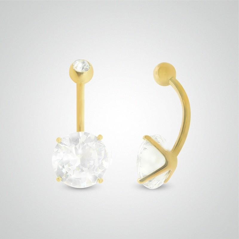 18 carats yellow gold belly button piercing with round jewel 10mm (3/8in) and zirconium oxide ball.