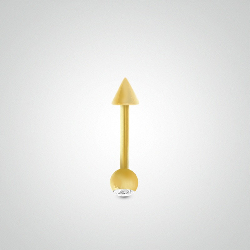 18 carats yellow gold genital piercing 1,2mm(16ga) with zirconium oxide ball and spike.
