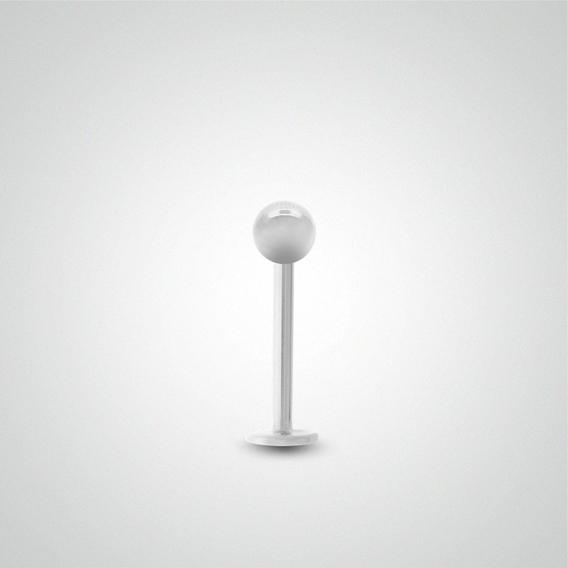18 carats white gold ball tragus piercing.
