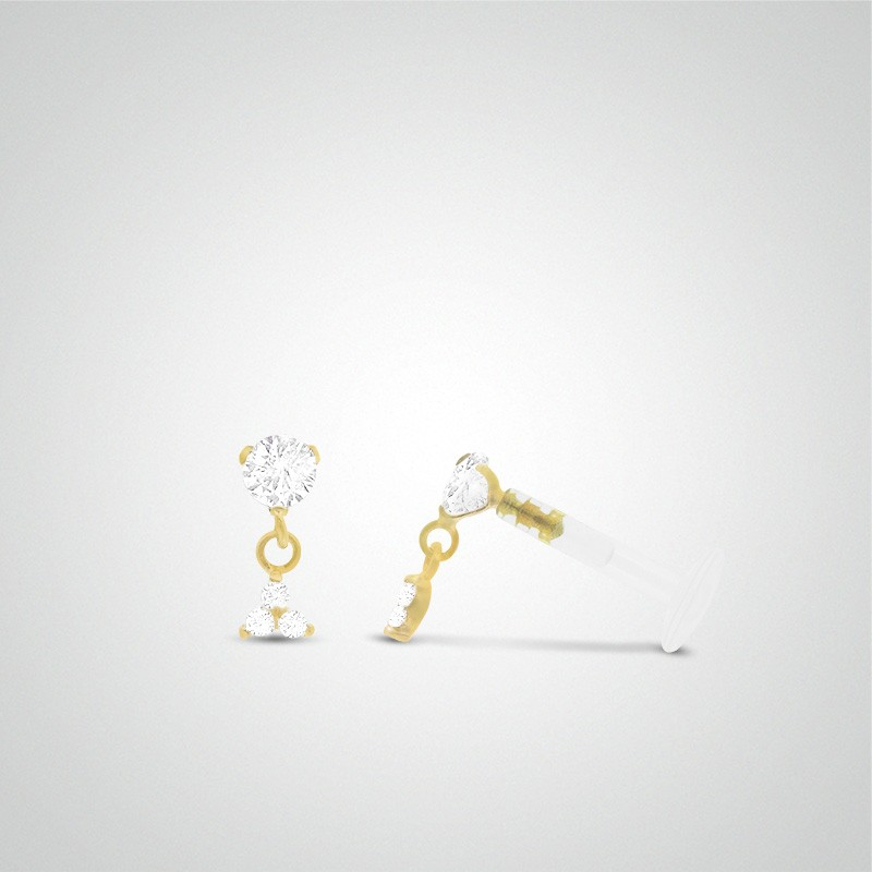 18 carats yellow gold three zirconium oxides pendant tragus piercing.