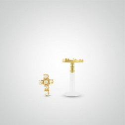 Yellow gold cross tragus piercing