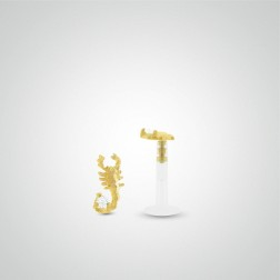 Yellow gold scorpion tragus piercing