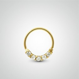 Yellow gold easy to open tragus ring with zirconium oxides